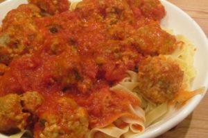 Sausage and Mozzarella Meatballs in Tomato Sauce